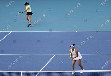 Shuko Aoyama (L) and Ena Shibahara (R) of Japan in action against Iga Swiatek of Poland and Bethanie Mattek-Sands of the USA during their semi-final Women's doubles match at the Miami Open tennis tournament in Miami Gardens, Florida, USA, 02 April 2021.