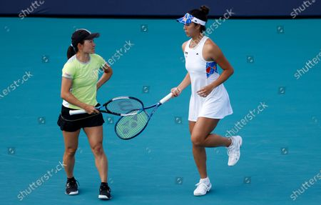 Stock Photo of Shuko Aoyama (L) and Ena Shibahara (R) of Japan in action against Iga Swiatek of Poland and Bethanie Mattek-Sands of the USA during their semi-final Women's doubles match at the Miami Open tennis tournament in Miami Gardens, Florida, USA, 02 April 2021.