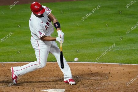 Los Angeles Angels' Albert Pujols (5) hits a home run during the fourth inning of an MLB baseball game against the Chicago White Sox, in Anaheim, Calif. Mike Trout and Justin Upton also scored