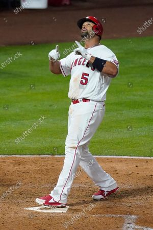 Los Angeles Angels' Albert Pujols (5) runs the bases after hitting a home run during the fourth inning of an MLB baseball game against the Chicago White Sox, in Anaheim, Calif. Mike Trout and Justin Upton also scored