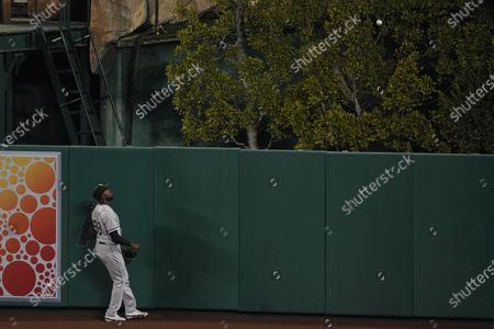 Chicago White Sox center fielder Luis Robert (88) watches as a ball hit by Los Angeles Angels' Albert Pujols (5) flies over the fence for a home run during the fourth inning of an MLB baseball game, in Anaheim, Calif. Los Angeles Angels' Mike Trout and Justin Upton also scored