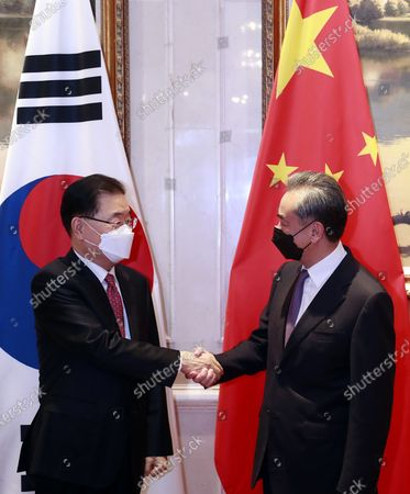 South Korean Foreign Minister Chung Eui-yong (L) and his Chinese counterpart Wang Yi (R) shake hands ahead of their talks in Xiamen, China, 03 April 2021. Chung is visiting China to discuss bilateral ties, the Korean Peninsula situation and regional and global issues.