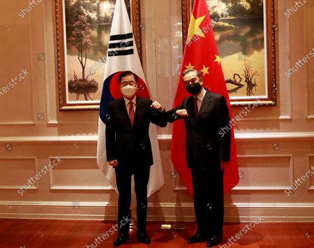 South Korean Foreign Minister Chung Eui-yong (L) and his Chinese counterpart Wang Yi (R) bump elbows as they pose for photographs ahead of their talks in Xiamen, China, 03 April 2021. Chung is visiting China to discuss bilateral ties, the Korean Peninsula situation and regional and global issues.
