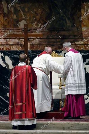 Stock Photo of Pope Francis celebrates Good Friday Mass for the Passion of the Lord at St. Peter's Basilica in the Vatican, during the Covid-19 coronavirus pandemic