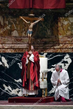 Stock Picture of Pope Francis celebrates Good Friday Mass for the Passion of the Lord at St. Peter's Basilica in the Vatican, during the Covid-19 coronavirus pandemic