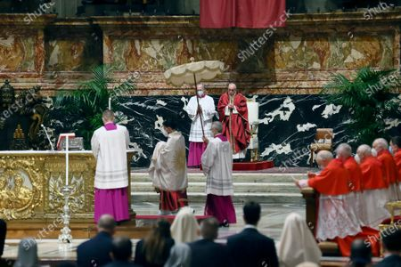 Stock Image of Pope Francis celebrates Good Friday Mass for the Passion of the Lord at St. Peter's Basilica in the Vatican, during the Covid-19 coronavirus pandemic