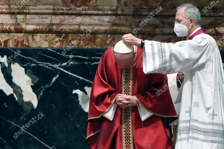 Pope Francis celebrates Good Friday Mass for the Passion of the Lord at St. Peter's Basilica in the Vatican, during the Covid-19 coronavirus pandemic