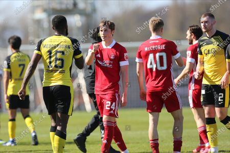 Aberdeen's Dean Campbell (24) shakes hands with Nathaniel Wedderburn (16) of Dumbarton during the Scottish FA Cup match between Dumbarton and Aberdeen at the C&G Systems Stadium, Dumbarton