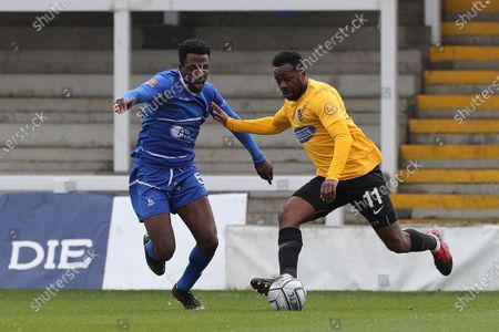 :Timi Odusina of Hartlepool United in action with Myles Weston of Dagenham during the Vanarama National League match between Hartlepool United and Dagenham and Redbridge at Victoria Park, Hartlepool on Friday 2nd April 2021.