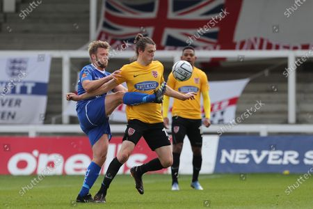 :Matt Robinson of Dagenham in action with Hartlepool United's Nicky Featherstone   during the Vanarama National League match between Hartlepool United and Dagenham and Redbridge at Victoria Park, Hartlepool on Friday 2nd April 2021.