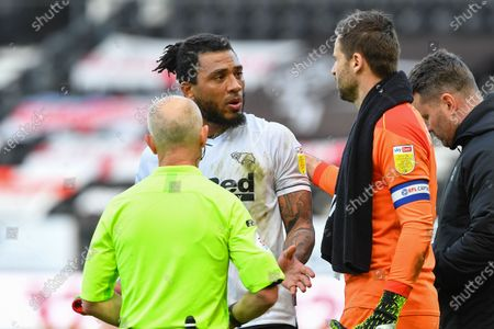 Derby County goalkeeper David Marshall tells Colin Kazim-Richards of Derby County to calm down as Referee, Andy Woolmer wants a word after the final whistle during the Sky Bet Championship match between Derby County and Luton Town at the Pride Park, Derby on Friday 2nd April 2021.