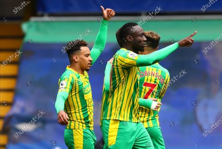 West Bromwich Albion's Matheus Pereira, left, celebrates scoring their side's first goal during the English Premier League soccer match between Chelsea and West Bromwich Albion at Stamford Bridge stadium in London, England