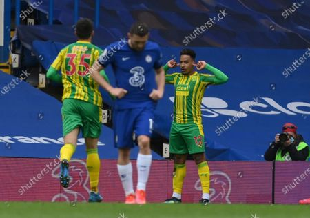 West Bromwich Albion's Matheus Pereira celebrates scoring their side's first goal during the English Premier League soccer match between Chelsea and West Bromwich Albion at Stamford Bridge stadium in London, England