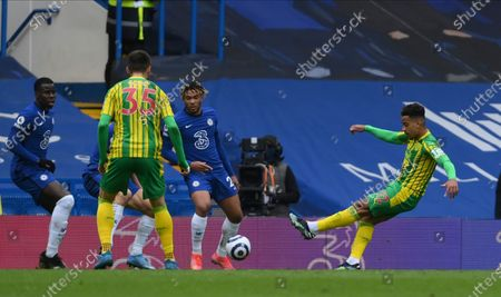 West Bromwich Albion's Matheus Pereira scores his side's opening goal during the English Premier League soccer match between Chelsea and West Bromwich Albion at Stamford Bridge stadium in London, England