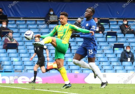 West Bromwich Albion's Matheus Pereira scores their side's first goal during the English Premier League soccer match between Chelsea and West Bromwich Albion at Stamford Bridge stadium in London, England