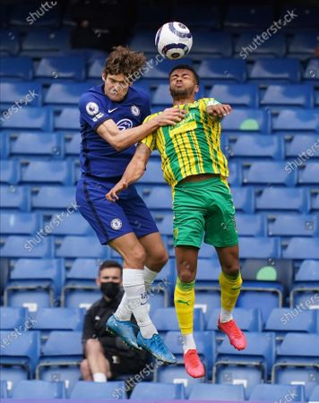 Chelsea's Marcos Alonso, left, and West Bromwich Albion's Matheus Pereira challenge for the ball during the English Premier League soccer match between Chelsea and West Bromwich Albion at Stamford Bridge stadium in London, England
