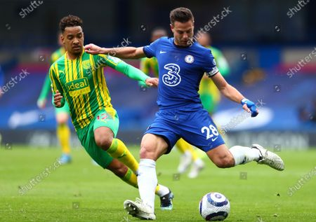 West Bromwich Albion's Matheus Pereira, left, and Chelsea's Cesar Azpilicueta challenge for the ball during the English Premier League soccer match between Chelsea and West Bromwich Albion at Stamford Bridge stadium in London, England