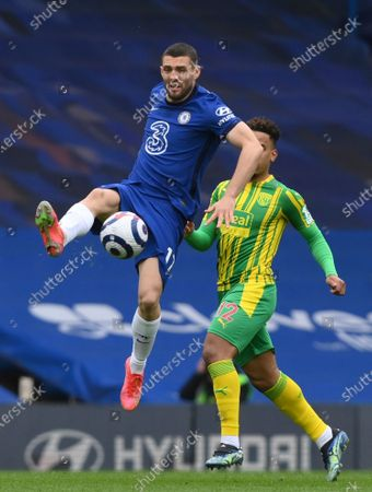 Chelsea's Mateo Kovacic, left, and West Bromwich Albion's Matheus Pereira challenge for the ball during the English Premier League soccer match between Chelsea and West Bromwich Albion at Stamford Bridge stadium in London, England