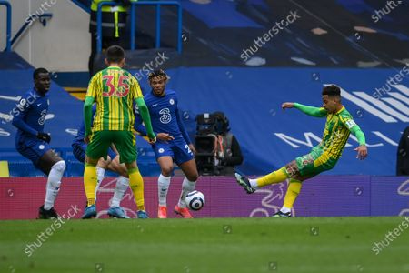 Stock Image of Matheus Pereira (R) of West Bromwich scores a goal during the English Premier League soccer match between Chelsea FC and West Bromwich Albion in London, Britain, 03 April 2021.