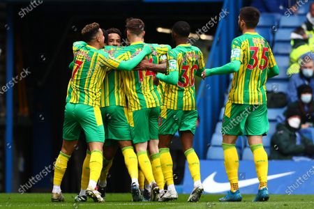 Matheus Pereira (2-L) of West Bromwich celebrates with teammates after scoring a goal during the English Premier League soccer match between Chelsea FC and West Bromwich Albion in London, Britain, 03 April 2021.