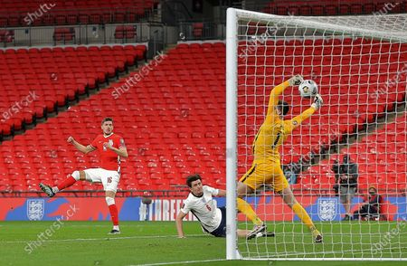 Jakub Moder of Poland scores his sides first goal past Nick Pope of England