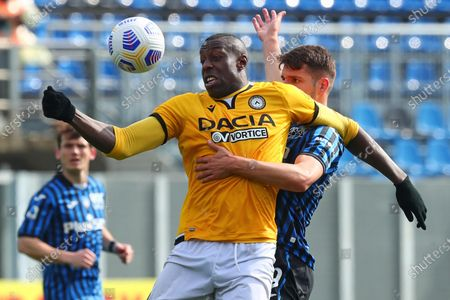 Atalanta's Berat Djimsiti (R) and Udinese's Stefano Okaka in action during the Italian Serie A soccer match Atalanta BC vs Udinese Calcio at the Gewiss Stadium in Bergamo, Italy, 03 April 2021.