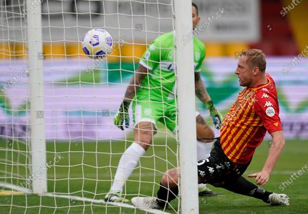 Benevento's Kamil Glik (R) scores during the the Italian Serie A soccer match Benevento Calcio vs Parma Calcio at Ciro Vigorito stadium in Benevento, Italy, 03 April 2021.