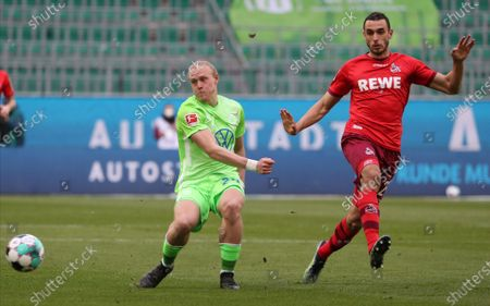 Wolfburg's Xaver Schlager (L) in action against Cologne's Ellyes Skhiri (R) during the German Bundesliga soccer match between VfL Wolfsburg and 1. FC Koeln in Wolfsburg, Germany, 03 April 2021.
