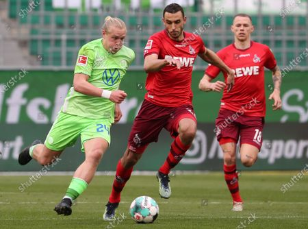 Stock Picture of Wolfburg's Xaver Schlager (L) in action against Cologne's Ellyes Skhiri (C) and Cologne's Ondrej Duda during the German Bundesliga soccer match between VfL Wolfsburg and 1. FC Koeln in Wolfsburg, Germany, 03 April 2021.