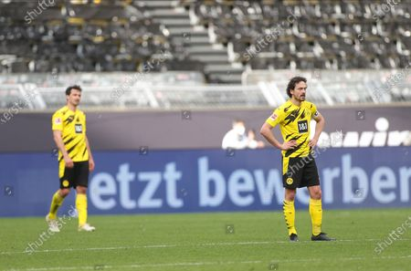 Dortmund's Mats Hummels (L) and Thomas Delaney react after Frankfurt's second goal during the German Bundesliga soccer match between Borussia Dortmund and Eintracht Frankfurt at Signal Iduna Park in Dortmund, Germany, 03 April 2021.