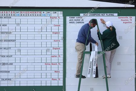 Scoreboard workers add names of past champions not playing in the 2021 Masters including Tiger Woods, shortly after Tsubasa Kajitani of Japan won on the first playoff hole during the final round of the Augusta National Women's Amateur at the Augusta National Golf Club in Augusta, Georgia, USA, 03 April 2021. The 2021 Masters Tournament will be held 08 April through 11 April 2021.