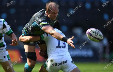 Alun Wyn Jones of Ospreys is tackled by Matias Orlando of Newcastle.