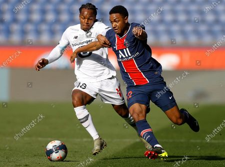Paris Saint Germain's Abdou Diallo (R) and Renato Sanches  of Lille OSC (L) in action during the French Ligue 1 soccer match between Paris Saint German and Lille OSC, in Paris, France, 03 April 2021.