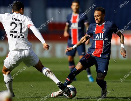 Paris Saint Germain's Neymar Jr (R) and Benjamin Andre of Lille OSC (L) in action during the French Ligue 1 soccer match between Paris Saint German and Lille OSC, in Paris, France, 03 April 2021.
