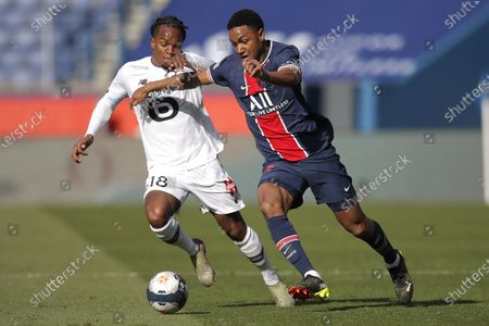 PSG's Abdou Diallo, right, fights for the ball with Lille's Renato Sanches during the French League One soccer match between Paris Saint Germain and Lille, at the Parc des Princes stadium, in Paris, France