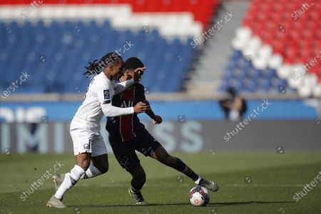 PSG's Abdou Diallo, right, fights for the ball withLille's Renato Sanches during the French League One soccer match between Paris Saint Germain and Lille, at the Parc des Princes stadium, in Paris, France