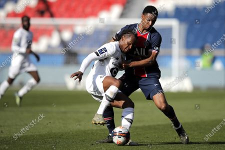 Stock Photo of PSG's Abdou Diallo, right, fights for the ball with Lille's Renato Sanches during the French League One soccer match between Paris Saint Germain and Lille, at the Parc des Princes stadium, in Paris, France