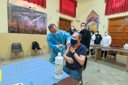 Father Filippo Sarullo (R), parish priest of the cathedral of Palermo, receives a jab during  vaccination against Covid-19, in Palermo, Italy, 03 April 2021. The Italian Regional Affairs Minister Mariastella Gelmini said on 02 April that Italy set a new record of over 300,000 COVID-19 vaccinations on 01 April.