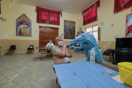 People are vaccinated against Covid-19 in the cathedral of Palermo, Italy, 03 April 2021. The Italian Regional Affairs Minister Mariastella Gelmini said on 02 April that Italy set a new record of over 300,000 COVID-19 vaccinations on 01 April.