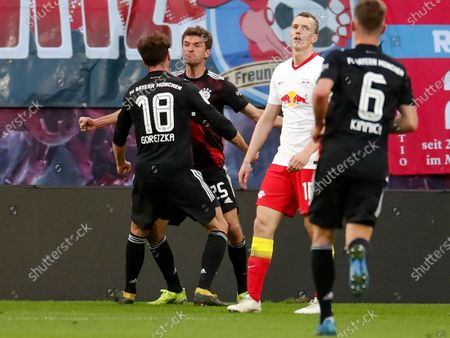 Stock Picture of Bayern's Leon Goretzka (L) celebrates with teammate Thomas Mueller (2-L) after scoring the opening goal during the German Bundesliga soccer match between RB Leipzig and FC Bayern Munich at Red Bull Arena in Leipzig, Germany, 03 April 2021.