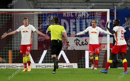 Leipzig's Alexander Soerloth (L), Yussuf Poulsen (2-R) and Dayot Upamecano (R) react during the German Bundesliga soccer match between RB Leipzig and FC Bayern Munich at Red Bull Arena in Leipzig, Germany, 03 April 2021.