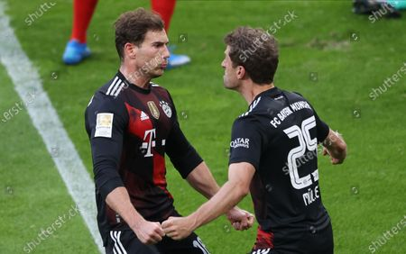 Stock Image of Bayern's Leon Goretzka (L) celebrates with teammate Thomas Mueller after scoring the 0-1 lead during the German Bundesliga soccer match between RB Leipzig and FC Bayern Munich at Red Bull Arena in Leipzig, Germany, 03 April 2021.