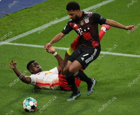 Leipzig's Nordi Mukiele (L) in action against Bayern's Serge Gnabry (R) during the German Bundesliga soccer match between RB Leipzig and FC Bayern Munich at Red Bull Arena in Leipzig, Germany, 03 April 2021.