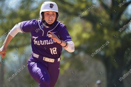Furman's Natalie Morgan runs to third during an NCAA college softball game against North Carolina Greenville, in Greenville, S.C. Furman won 4-1