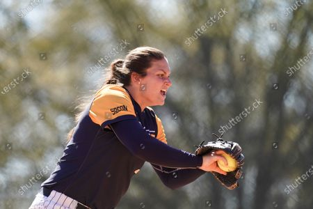 North Carolina Greenville's Hannah Stiltner delivers to a batter during an NCAA college softball game against North Carolina Greenville, in Greenville, S.C. Furman won 11-7
