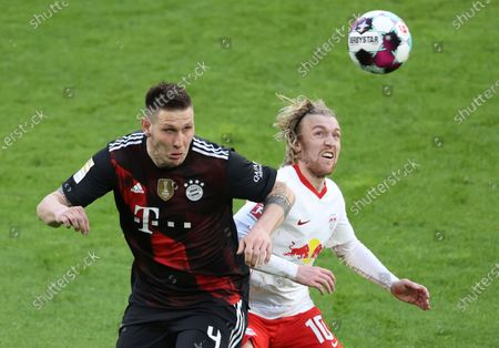 Bayern's Niklas Suele, left vies for the ball with Leipzig's Emil Forsberg during the German Bundesliga soccer match between RB Leipzig and Bayern Munich, in Leipzig, Germany