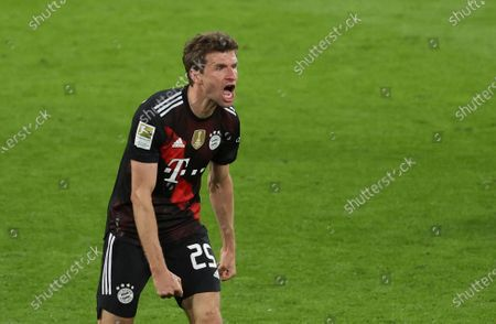 Bayern's Thomas Mueller shouts out and celebrates after the end of the German Bundesliga soccer match between RB Leipzig and Bayern Munich, in Leipzig, Germany, . Bayern won the game 1-0, with Bayern's Leon Goretzka scoring the only goal