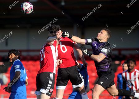 Derry City vs Waterford. Waterford keeper Brian Murphy punches clear from Cameron McJannet and Eoin Toal of Derry