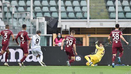 Torino's Salvatore Sirigu (2-R) and Juventus' Alvaro Morata (3-L) in action during the Italian Serie A soccer match Torino FC vs Juventus at the Olimpico Grande Torino Stadium in Turin, Italy, 03 April 2021.