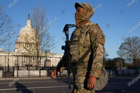 A member of the National Guard patrols outside a perimeter security fence at the US Capitol in Washington, DC, USA, 03 April 2021. Capitol Police Officer William Evans was killed and a second officer was injured when a suspect rammed a vehicle at a security checkpoint at the US Capitol, 02 April. The suspect, identified by law enforcement officials as Noah Green, was shot and killed in the incident. This attack on the Capitol follows the deadly mob riot of 06 Janaury that left dozens injured and five dead.